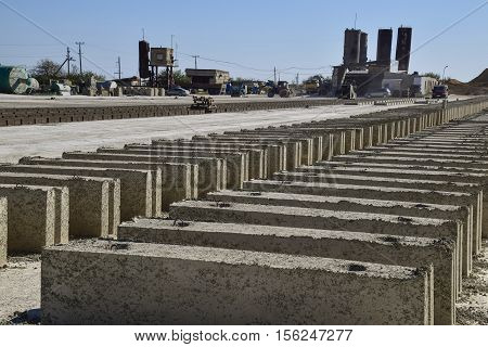 Cinder Blocks Lie On The Ground And Dried. On Cinder Block Production Plant.