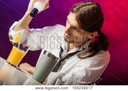 Young Bartender Pouring Beverages.