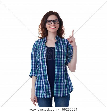 Smiling young woman in casual clothes and glasses over white isolated background pointing up, happy people concept