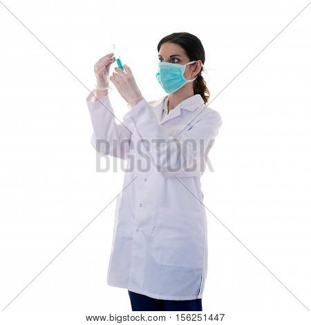 Female doctor in white coat over white isolated background in surgical mask with syringe, healthcare, profession and medicine concept