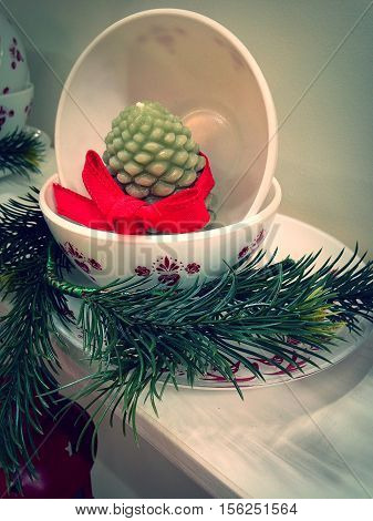 festive Christmas bowl plate candle and red bow placement