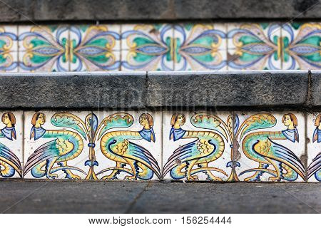 Details of the hand-decorated ceramic tiles of the 18th century Staircase of Santa Maria del Monte main landmark of Caltagirone Sicily. The town is famous for it's maiolica and terra-cotta wares. poster