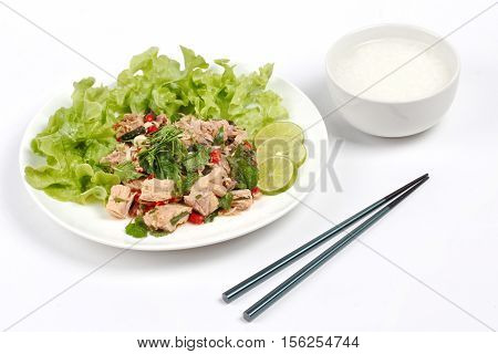 Rice Gruel And Spicy  Vegetable Salad With Canned Tuna Served .