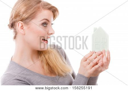 Housing property ownership family future finances concept. Smiling girl with home symbol. Young lady holding small house model.