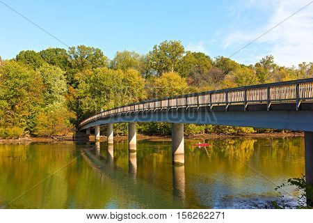 Footbridge bridge to the Theodore Roosevelt Island in Washington DC USA. Kayaking on Potomac River in early autumn.