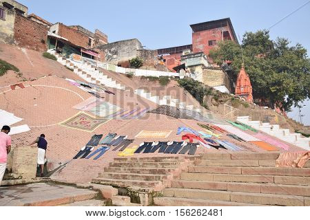 VARANASI, UTTAR PRADESH INDIA - FEBRUARY 17, 2016 - Pants and other clothes drying at the sun on the ghats