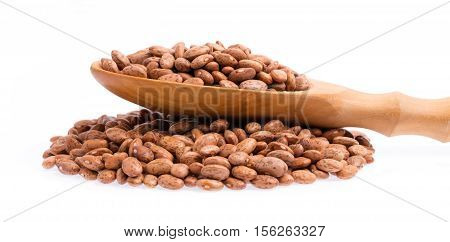 Pinto Beans With Ladle In Heap Of Beans Isolated On White Background