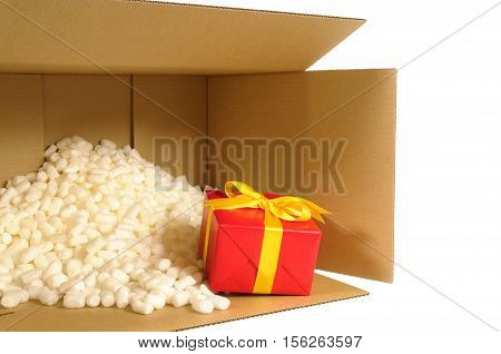 Cardboard Shipping Delivery Box With Red Gift Inside And Polystyrene Packing Pieces.