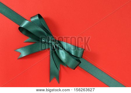 Green Gift Ribbon Bow Corner Diagonal On Red Paper Background