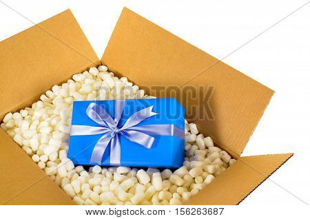 Cardboard Shipping Delivery Box With Blue Gift Inside And Polystyrene Packing Pieces.
