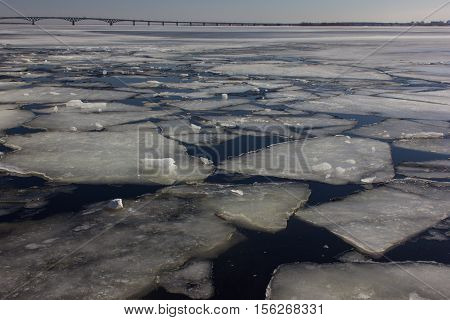Ice floes on the river. Great Volga River.