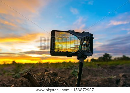 mobile phone shooting photo and time-lapse Beautiful color sunset sky