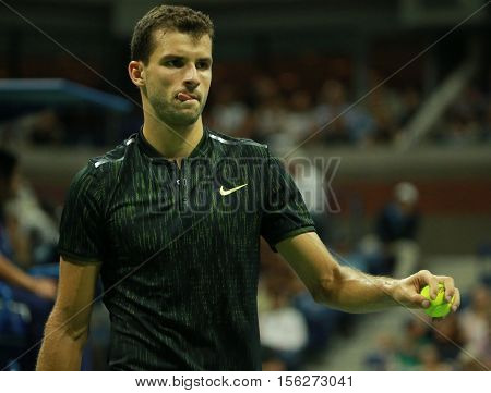 NEW YORK - SEPTEMBER 5, 2016: Professional tennis player Grigor Dimitrov of Bulgaria in action during US Open 2016 round four match at Billie Jean King National Tennis Center