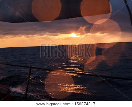 cinematic sunset in the sea with water drops