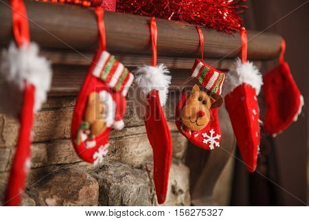 Christmas Red Stocking Hanging From A Mantel Or Fireplace, Decorated For.