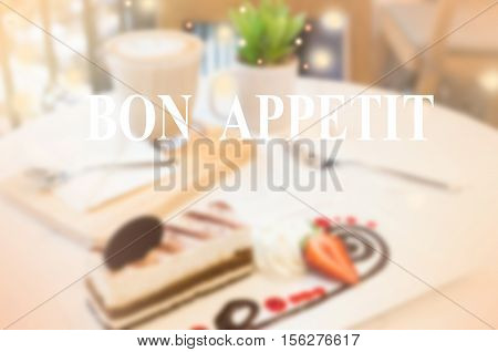 dessert on table in coffee time with word Bon Appetit Delicious Meal Concept