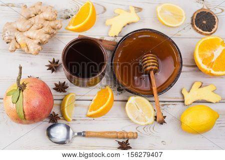 Natural flu and cold remedy - orange and lemon fruit fresh ginger honey - alternative medicine health concept