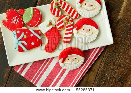 Delicious Christmas cookies in red tone on a wooden table