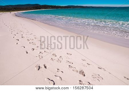 A track of footsteps leads along Binalong Bay beach at Bay of Fires, Tasmania which is world-famous for it's beautiful white beaches and clear waters.