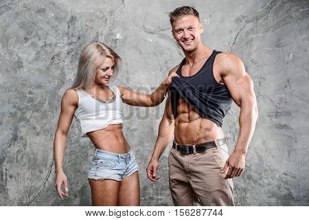 Beautiful Young Sporty Sexy Couple Men And A Woman Posing