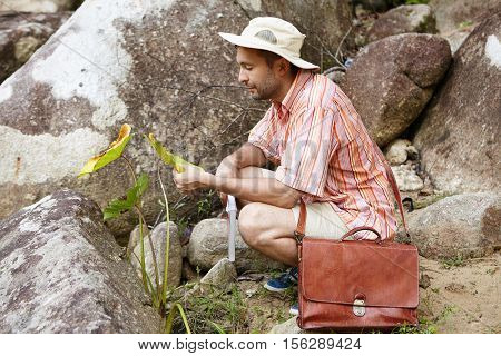 Ecology, Biology And Science Concept. Bearded Botanist Or Biologist With Briefcase Researching Quali