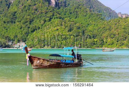 KRABI PHI-PHI THAILAND - NOVEMBER 29 2013: Longtrail boat on Loh samah bay at phi phi island.