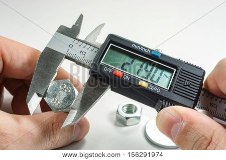 Measurements by a digital caliper in the master's hand