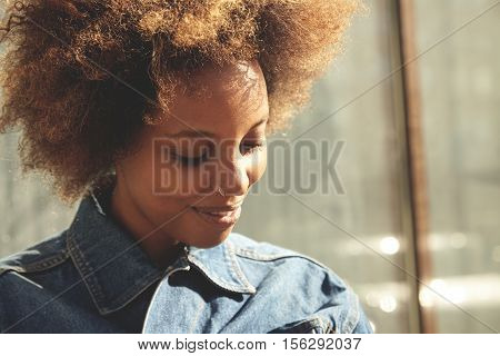 People And Lifestyle Concept. Fashionable Dark-skinned Girl With Healthy Skin And Nose-ring Dressed