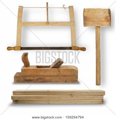 set of hand tools for joinery. Hand saw mallet planer stack of wooden planks isolated on white background