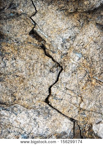 abstract background zigzag fissure in the limestone