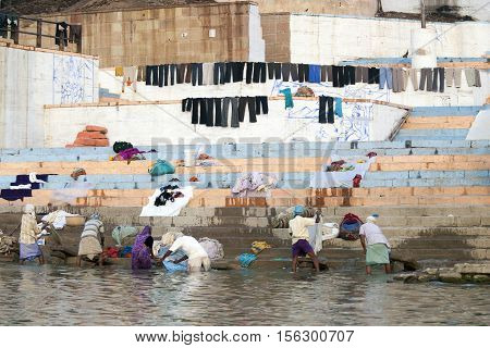 editorial photos people washed and dried linen on the waterfront Varanasi India November 2009
