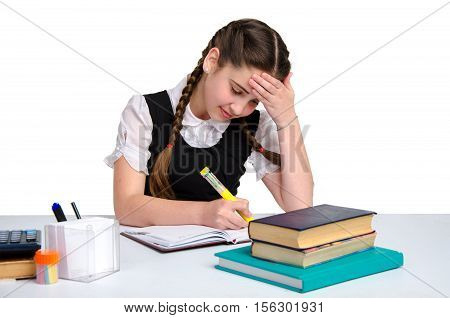 young thoughtful schoolgirl in unform doing exercises isolated on white background