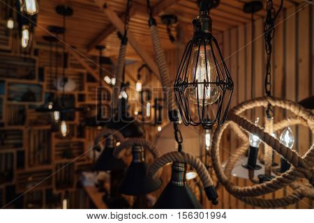 Modern fashion lamp Edison interior loft room. Lantern with filament.