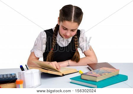 horizontal portrait of young schoolgirl in unform studying isolated on white background