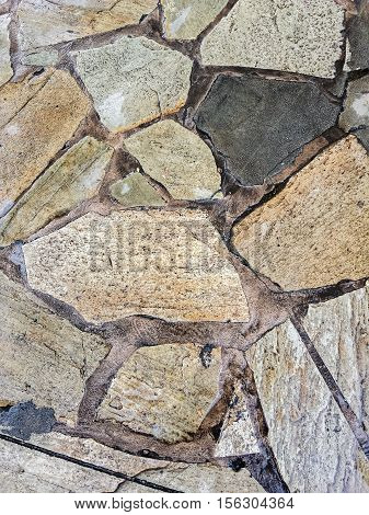 Sandstone pavers in irregular shapes and pattern arrangements. The textured surface is suitable for all kinds of graphic design work.