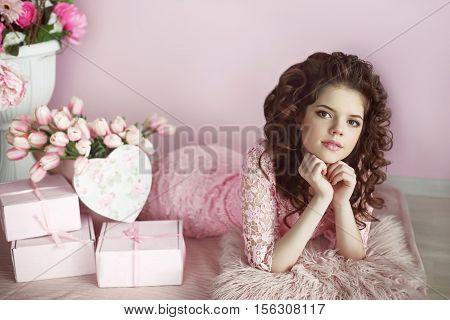 Beautiful Young Teen Girl Portrait, Romantic Surprise. Brunette In Pink Dress Over Bouquet Of Flower