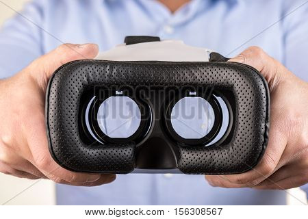 VR virtual reality glasses on hand high quality and high resolution studio shoot