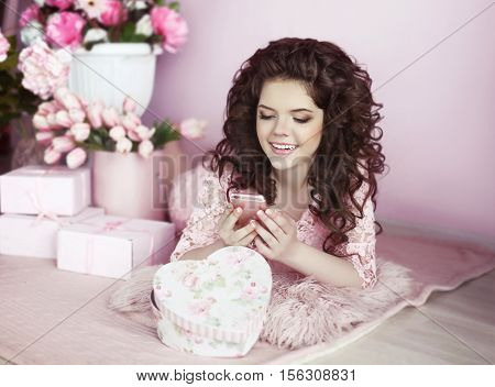 Beautiful Young Teen Girl Portrait Use Mobile Phone. Brunette In Pink Dress Over Bouquet Of Flowers