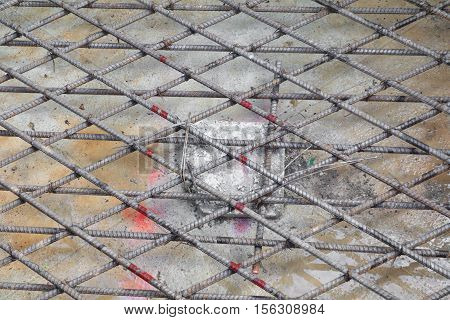 steel rebar in a construction site making reinforcement metal framework for concrete pouring