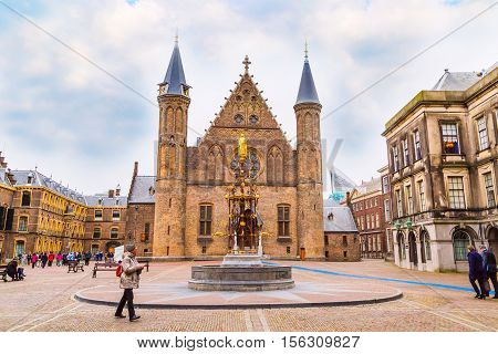 Hague, Netherlands - April 5, 2016: People near Binnenhof palace, place of dutch parliament in Hague or Den Haag, Holland, Netherlands