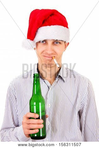 Young Man in Santa Hat with a Bottle of the Beer and Cigarette on the White Background