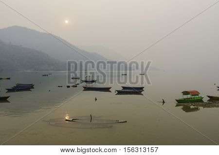 Phewa Lake by a hazy day in Pokhara, Nepal