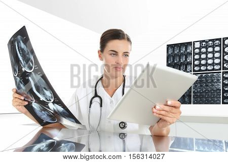 Radiologist woman checking xray with tablet healthcare medical and radiology concept