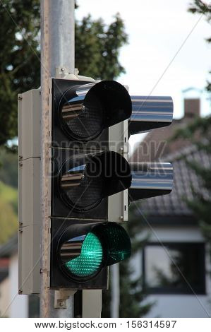 Green / Traffic light installed at the crossroads