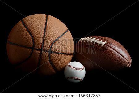 football basketball baseball on a black background