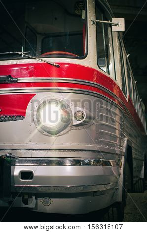 Part view of red old retro bus.