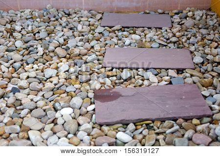 Gardening stone footpath with small stone in the garden