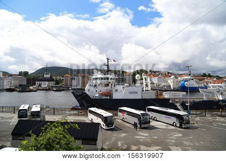 BERGEN N,ORWAY - JULY 3, 2016: This is one of the cargo and passenger sea berths town near the castle Bergenhus.