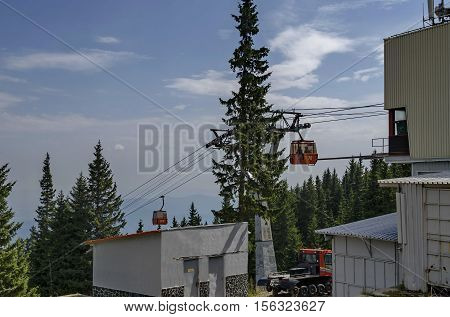 Station  of  contemporary ski tow or lift  in sunny day with blue sky  near by hija or rest-house Aleko, Cherni vrah or Black  peak, Vitosha mountain, Bulgaria