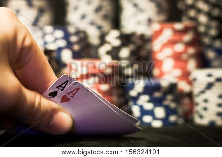 Closeup of play in poker table with chips